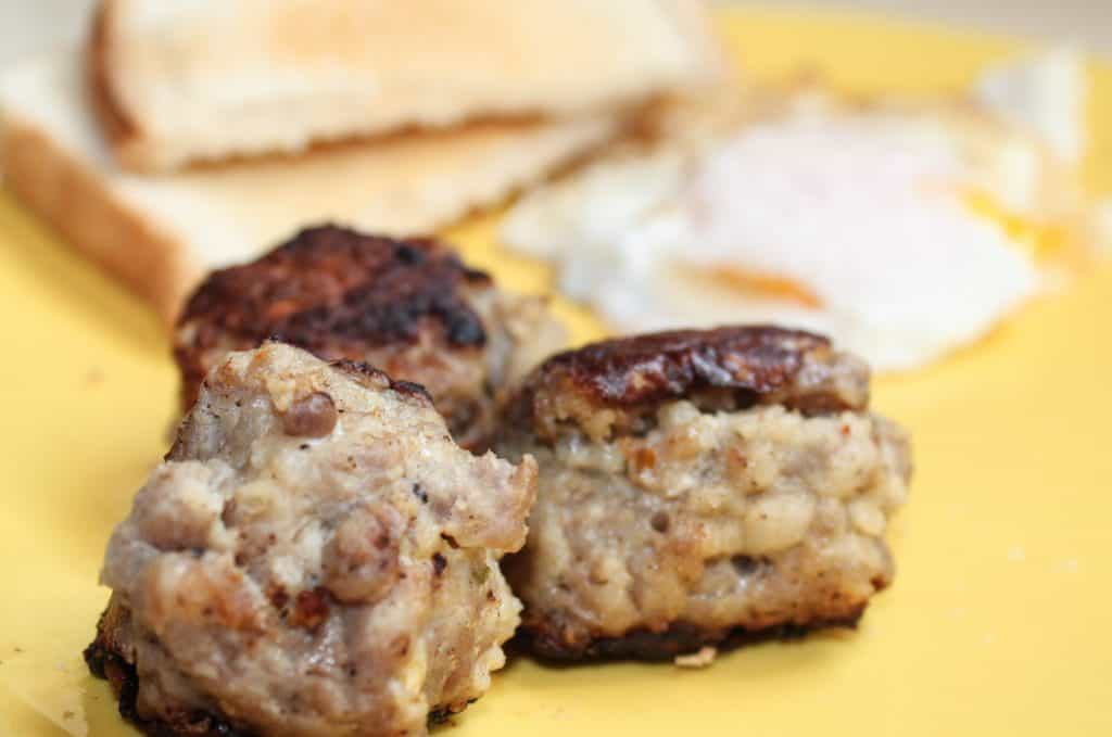 Breakfast meatballs on plate with eggs and toast
