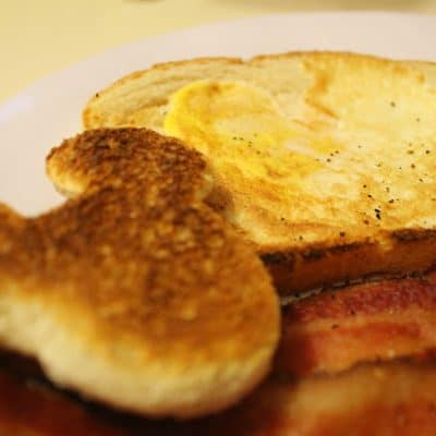 Mickey Mouse shaped egg-in-a-hole, bacon, and Mickey Ear Shaped Toast