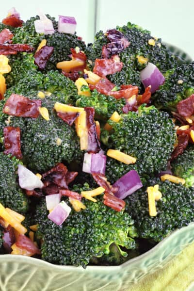green bowl filled with easy broccoli salad recipe