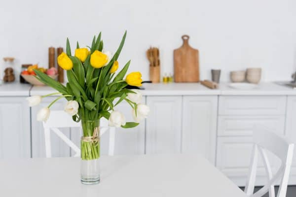 Yellow and White Tulips on Kitchen Table
