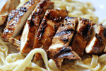 Grilled rosemary chicken on a bed of fresh pasta
