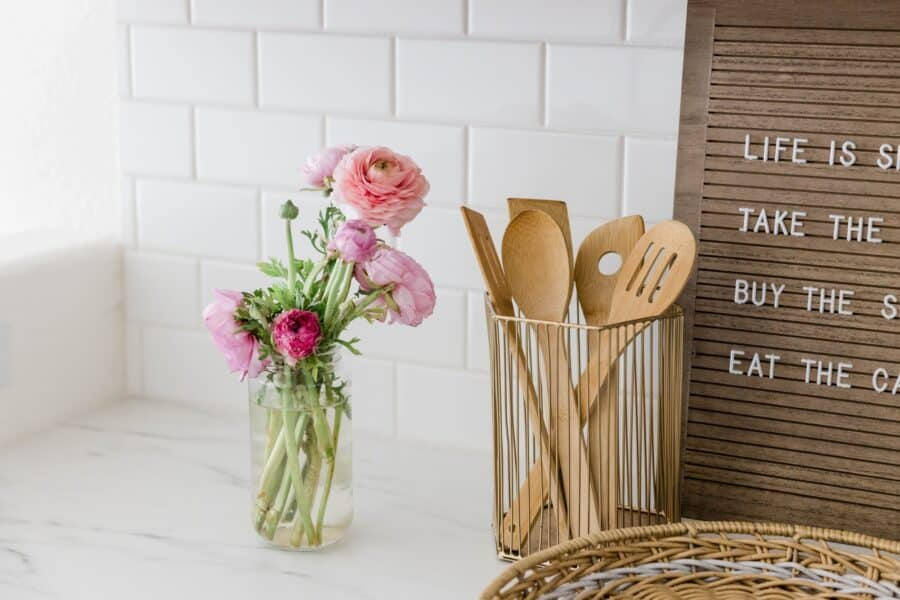 Flowers and kitchen utensils on a contertop
