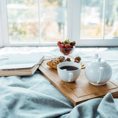 Tea Pot with Cup of Coffee in Bed