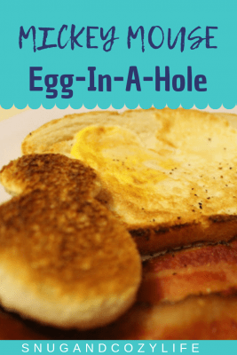 Mickey Mouse shaped toast, egg in a hole, and bacon on a white plate