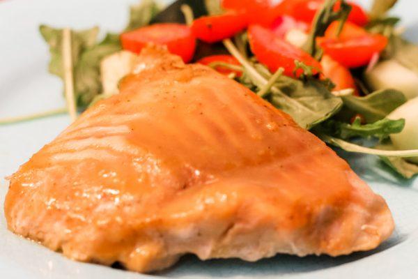 Maple Dijon Salmon & Salad on a blue plate