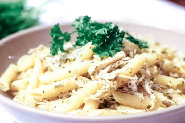 Pesto Chicken Pasta in a gray bowl with parsley