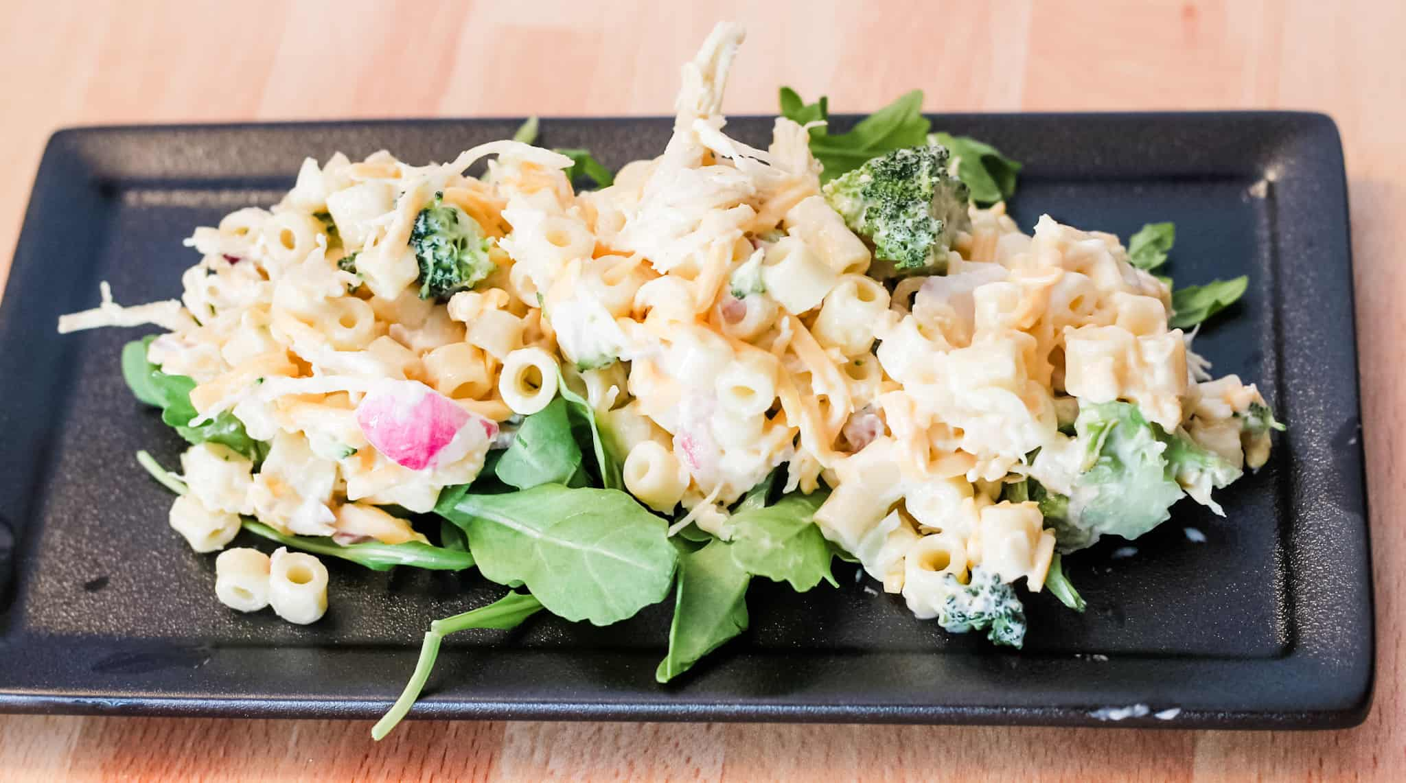 Cold Chicken Pasta Salad on a black rectangle plate