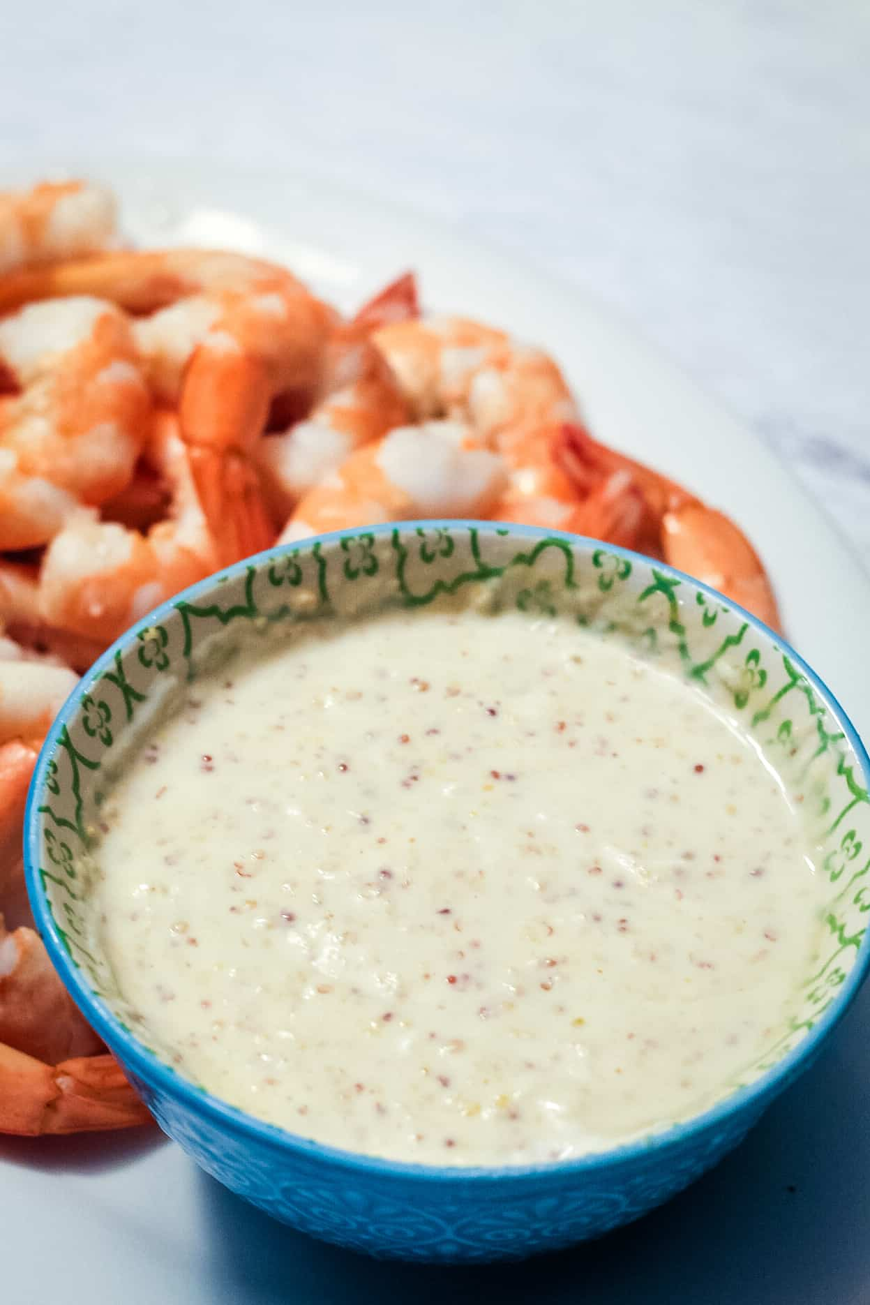 Cold Horseradish dip in a blue bowl with shrimp