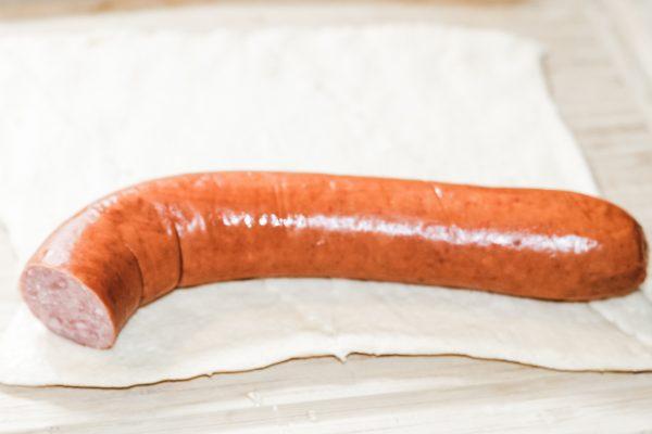 kielbasa layed on top of raw cresent dough