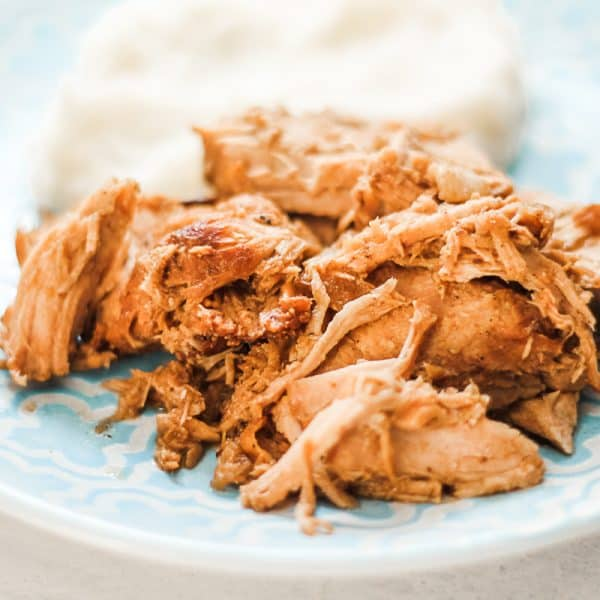 slow cooker balsamic pork and mashed potatoes on a blue plate