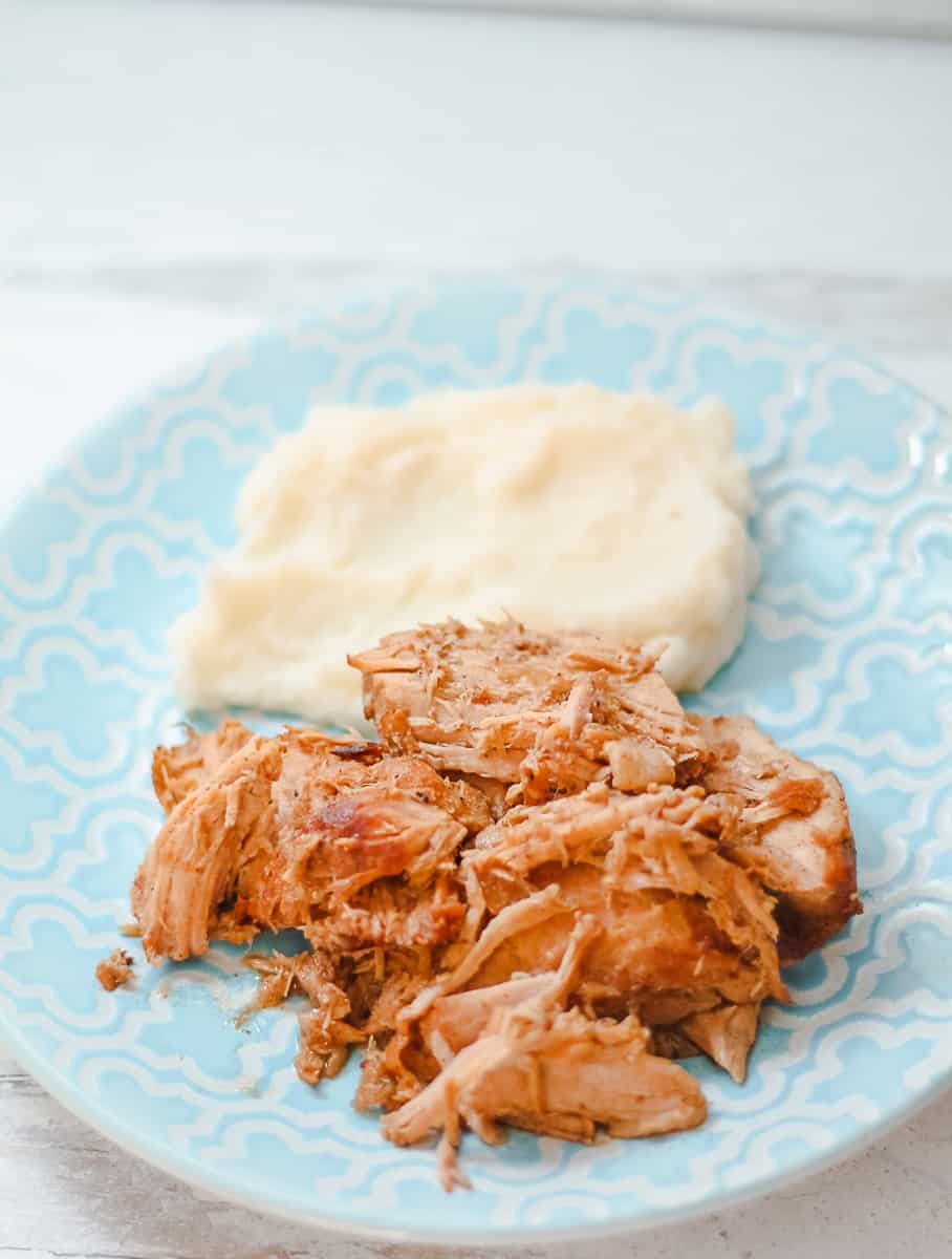 Balsamic Pulled Pork and Mashed Potatoes on a blue plate