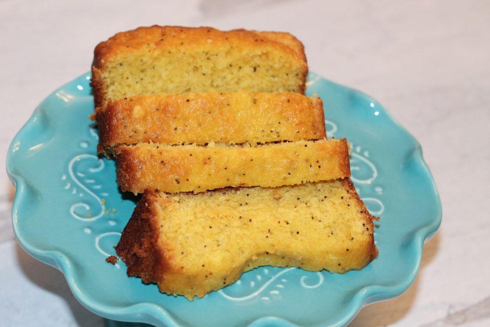 Sliced 5 Ingredient Lemon Poppy Seed Bread on a cakestand