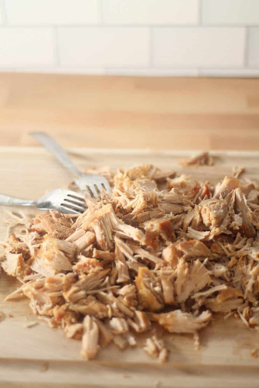 Slow Cooker Shredded Mexican Pork on a cutting board