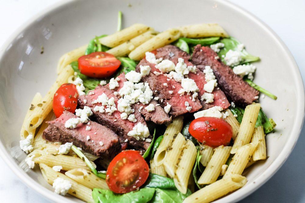 Steak pasta recipe in a gray bowl