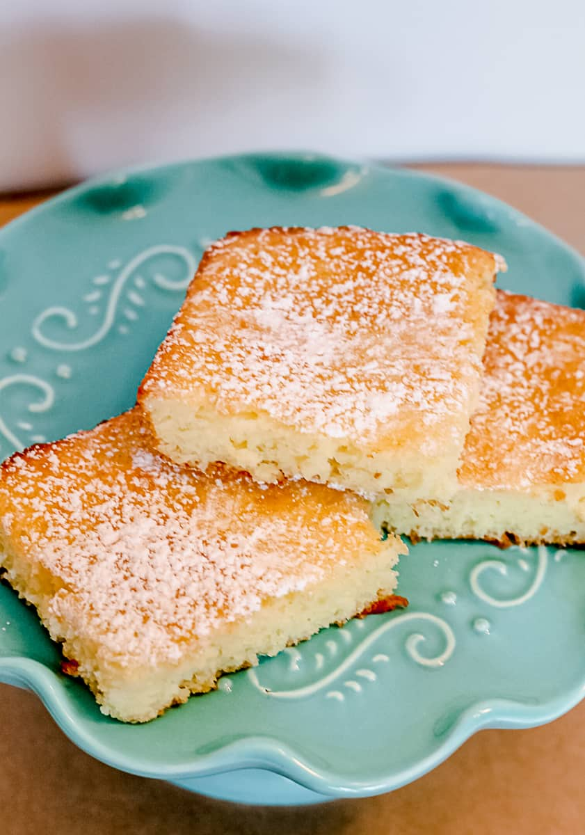 2 Ingredient Lemon Bars on A Teal Cake Stand