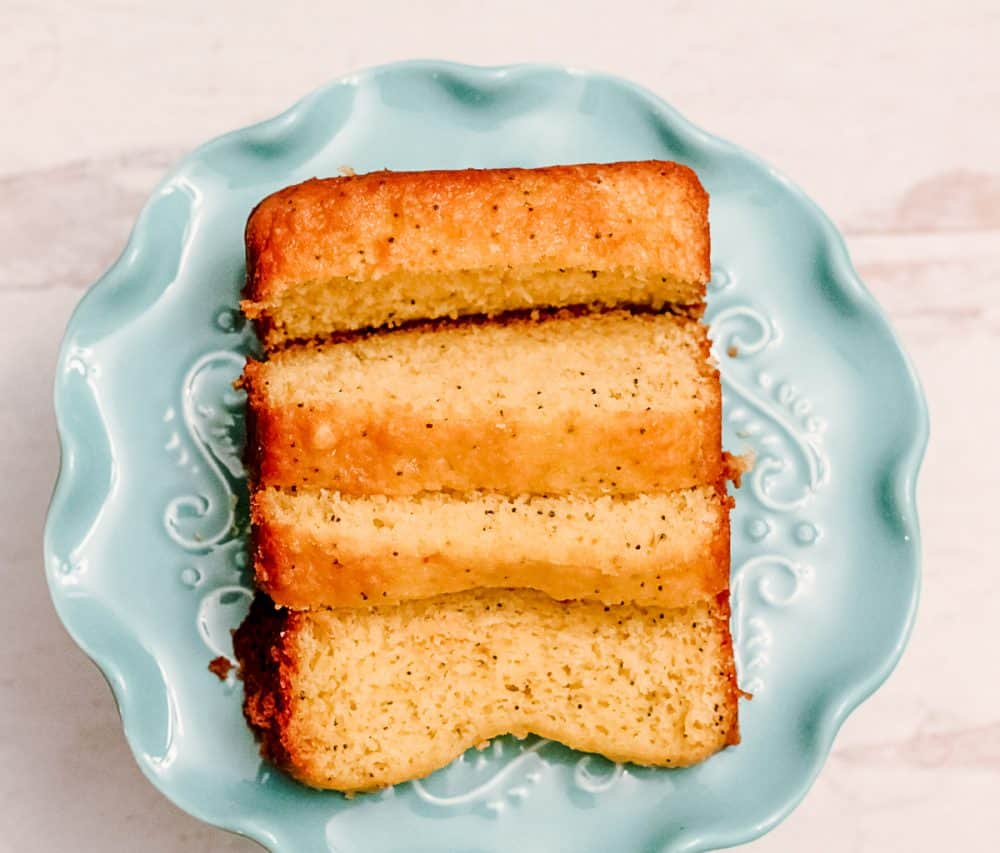 Lemon Poppy Seed Bread on a teal cake stand
