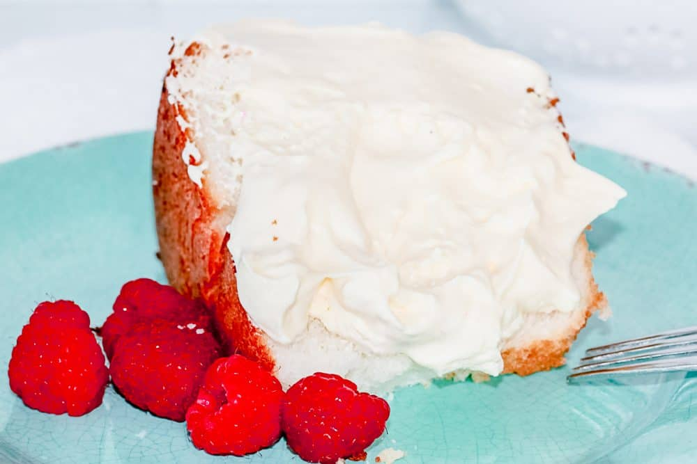angel food cake, raspberries, and easy bavarian cream on a teal plate