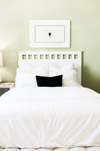 cozy bed with throw pillows