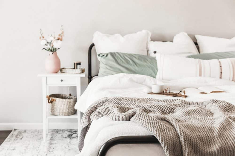 Comfortable Bed with duvet, throw blanket, and lots of pillows