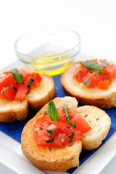 Italian brushetta; sliced baguette topped with a mixture of chopped tomato, garlic and basil