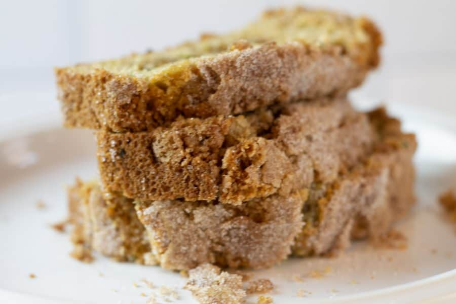 slices of snickerdoodle zucchini bread on a white plate