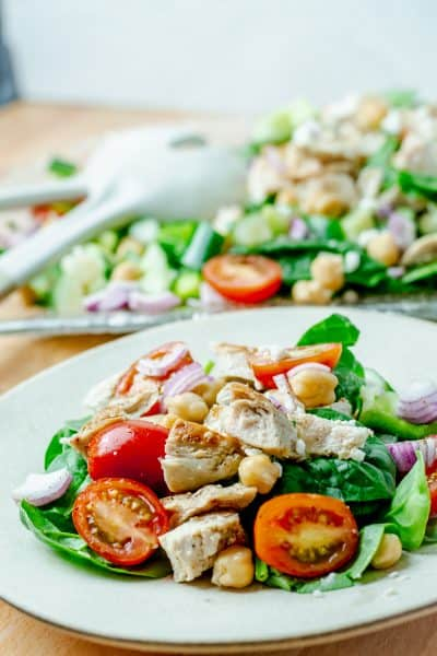 plate of chicken chickpea salad with tomatoes and red onions