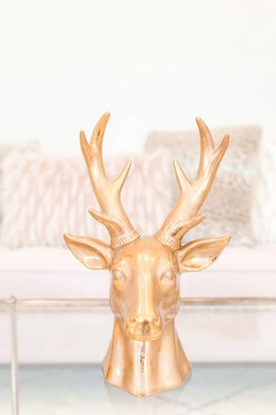 unique decoration of a gold deer's head in a cozy living room
