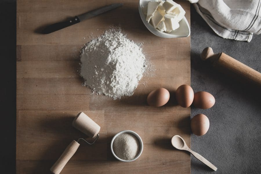 wooden cutting board with eggs, flour, and butter - used to create a hygge pantry