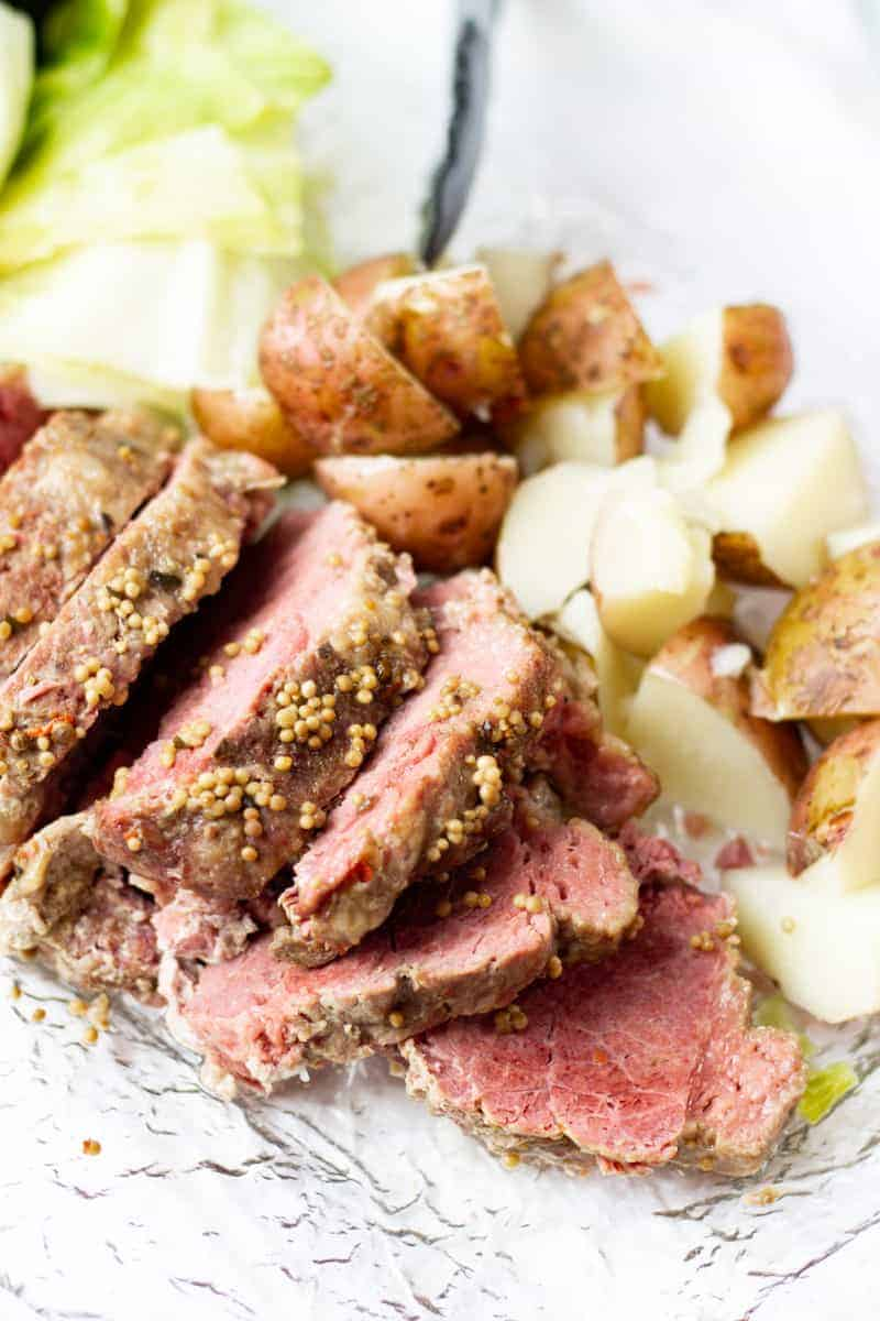 platter of corned beef, cabbage, and potatoes