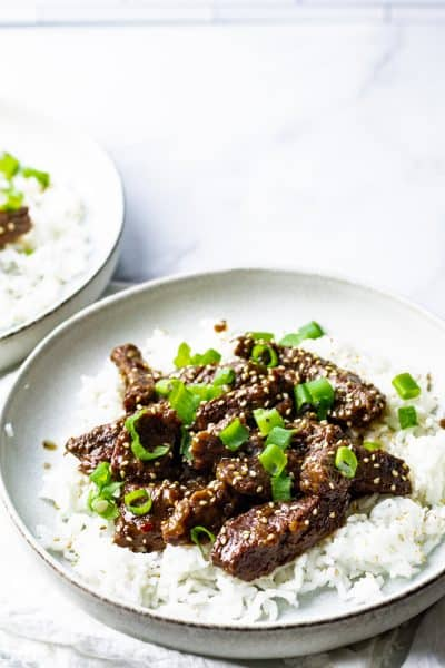 two bowls of mongolian beef