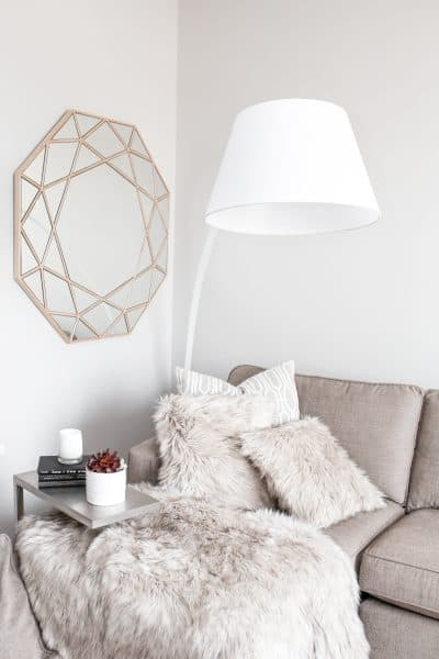 cozy living room with hygge fur blankets and pillows
