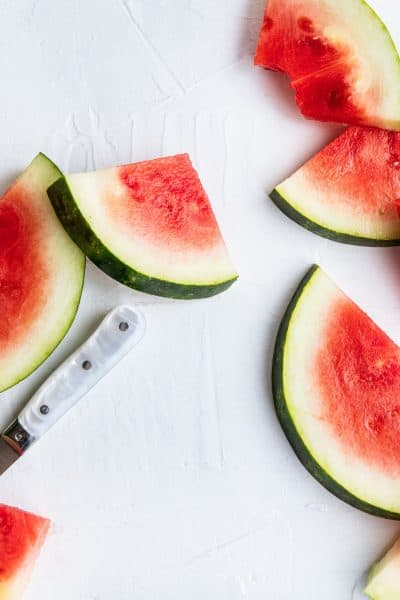 slices of watermelon on a white background