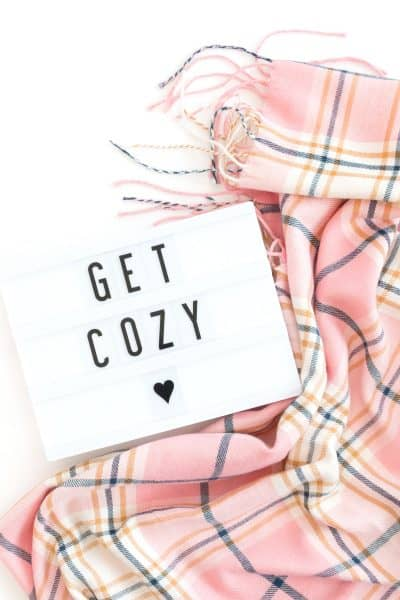 "hygge blanket scarf and ""get cozy"" sign"
