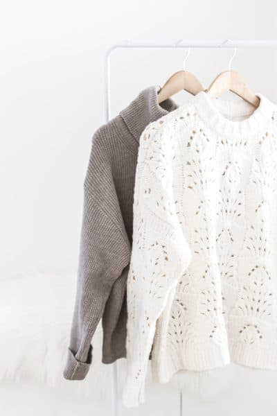 two cozy sweaters on hangers