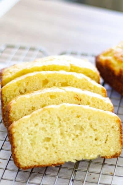 sliced easy lemon zucchini bread on a wire cooling rack