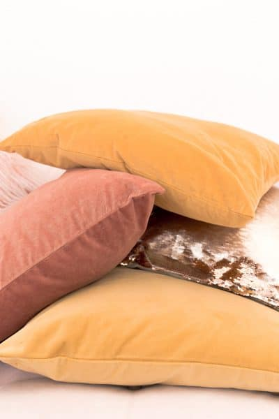 hygge pile of pillows in fall colors