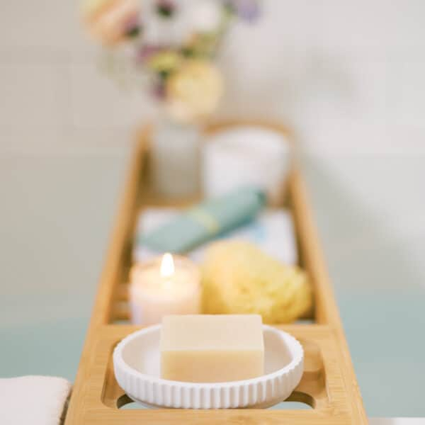 tray with a candle, soap, and various cozy home spa day essentials
