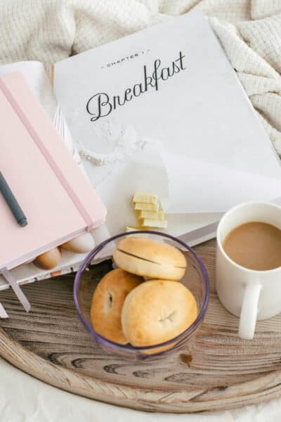 gray with bagels, coffee, and a book