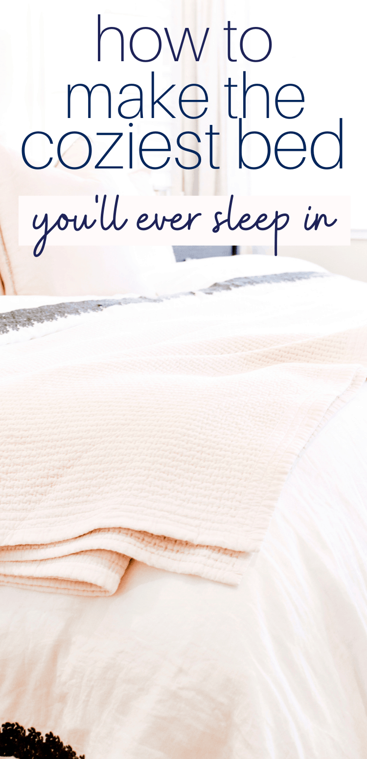 Photo of a cozy bed with layers of pillows and blankets