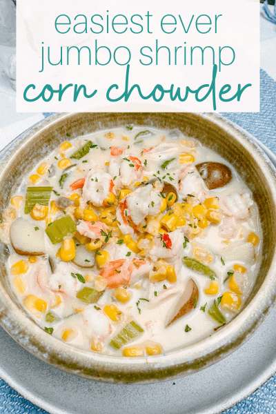 bowl of shrimp corn chowder with potatoes on a placemat