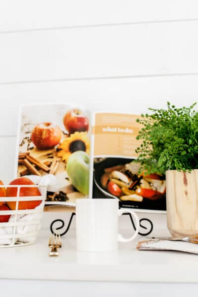 cookbook, mug, and plant in a cozy hygge kitchen