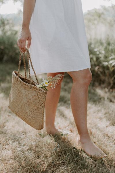 non descript woman walking in field