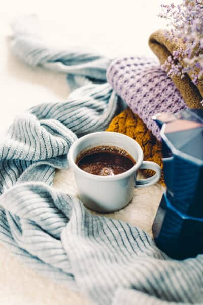 chunky knit blankets, french press, and a cup of coffee